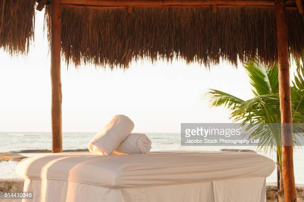 Bed in hut on tropical beach