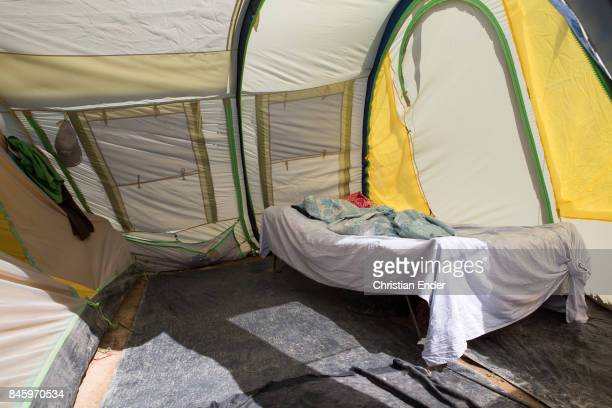 PortauPrince Haiti December 09 2012 A bed inside a tent in Close up at the string that stabilize a tent in the refugee camp Parc Colofe in...