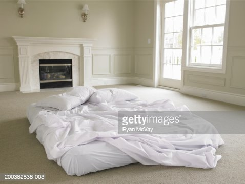Bed On Floor In Center Of Empty Living Room Stock Photo Getty Images