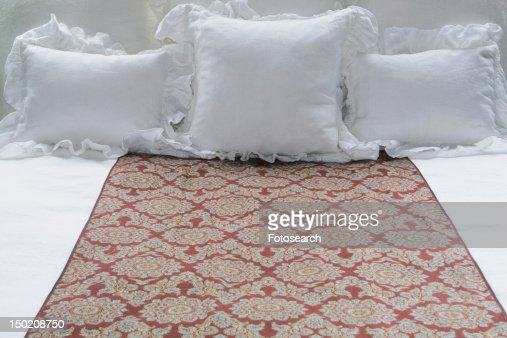 Throw Pillows On The Bed Song : Bed Runner And Throw Pillows On Bed Stock Photo Getty Images