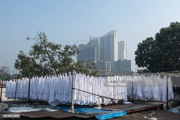 Bed sheets hang on a roof at the Mumbai's Dhobi Ghat a large open air laundromat where workers wash clothes from hotels hospitals and factories