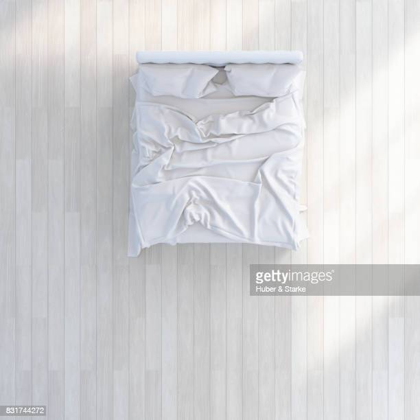 bed with ruffled beddings