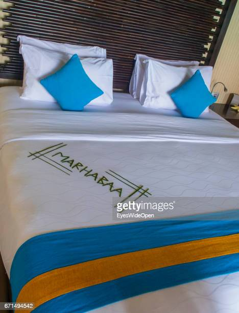 Bed with Welcome in Dhivehi Language in a Water Villa at Coco Bodu Hiti NorthMaleAtoll on February 23 2017 in Male Maldives