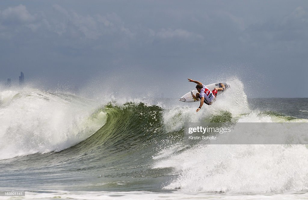 Bede Durbidge of Australia performs an aerial maneuever during the Quiksilver Pro on March 11, 2013 in Gold Coast, Australia.