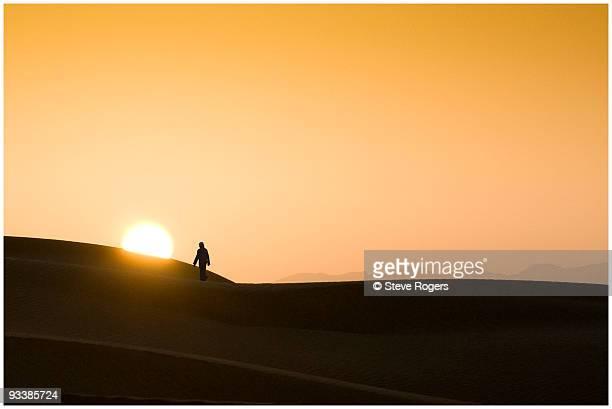 Bedouin and Sunrise in Oman Desert