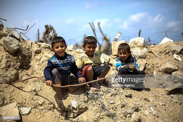 Bedouin boys are seen near their makeshift huts without water and basic living necessities at Khan Younis in Gaza City Gaza on July 28 2016 After...