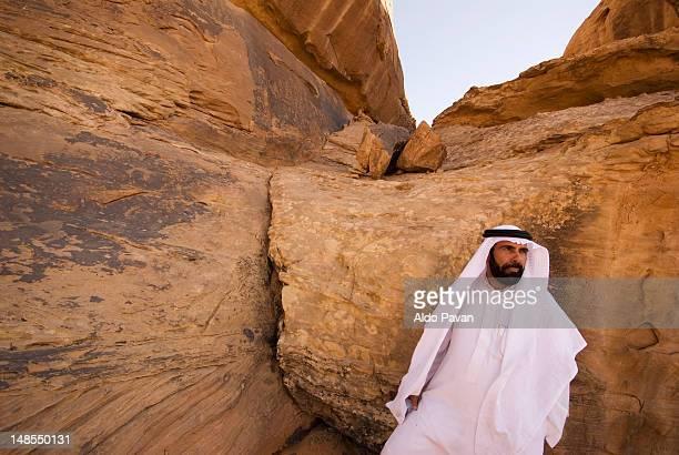 Bedouin by rocks.