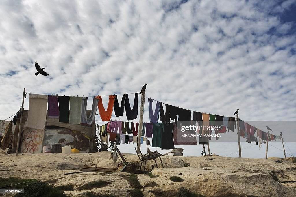 A Bedouin camp is seen in the E1 area, between Jerusalem and the Israeli West Bank settlement of Maale Adumim, on December 3, 2012. Paris and London called in Israel's envoys for consultations as the Jewish state faced mounting diplomatic pressure over plans to build 3,000 settler homes in E1 and east Jerusalem and the West Bank. AFP PHOTO/MENAHEM KAHANA
