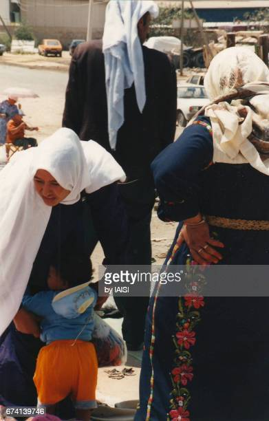 A Bedouin family at the market of Beersheba in the Negev desert