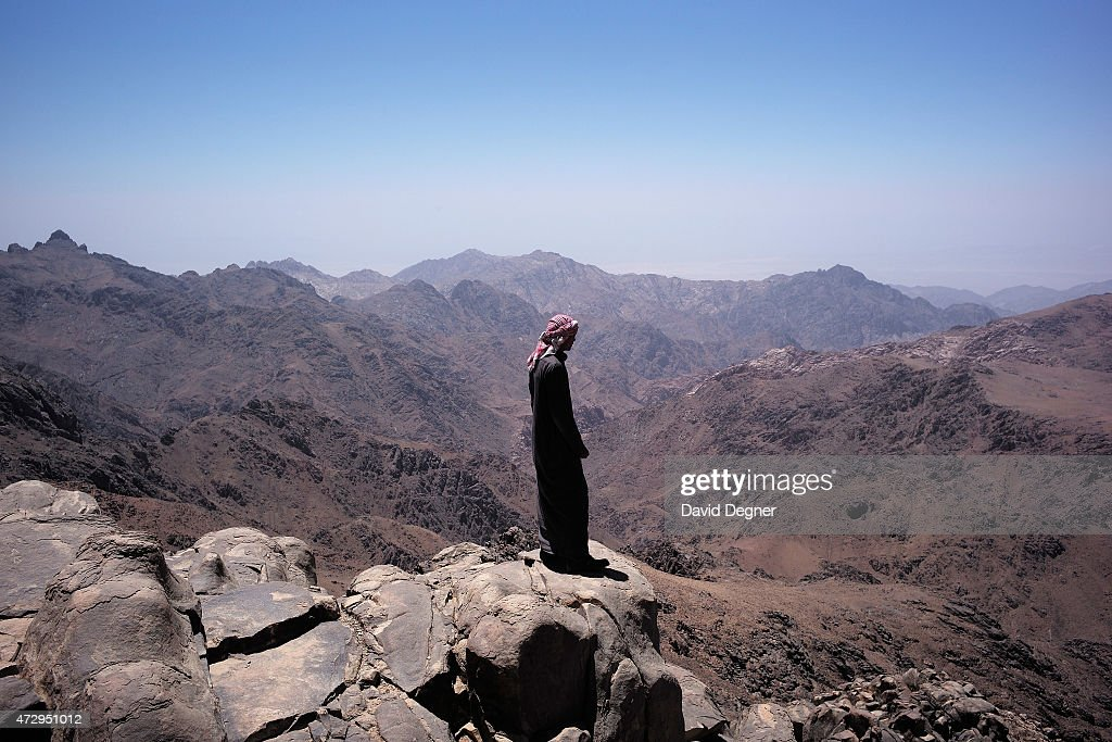 A Bedouin guide stands on the top of Mount Katherine, part of a group leading tourists hiking through the mountains of South Sinai on April 18, 2015 near St. Catherine, Egypt. Bedouins guides in the Sinai peninsula face stiff competition and many Sinai Bedouins are unemployed due to the lack of employment opportunities.