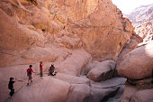 Bedouin guides lead tourists hiking through the mountains of South Sinai on April 17 2015 near St Catherine Egypt Bedouins guides in the Sinai...