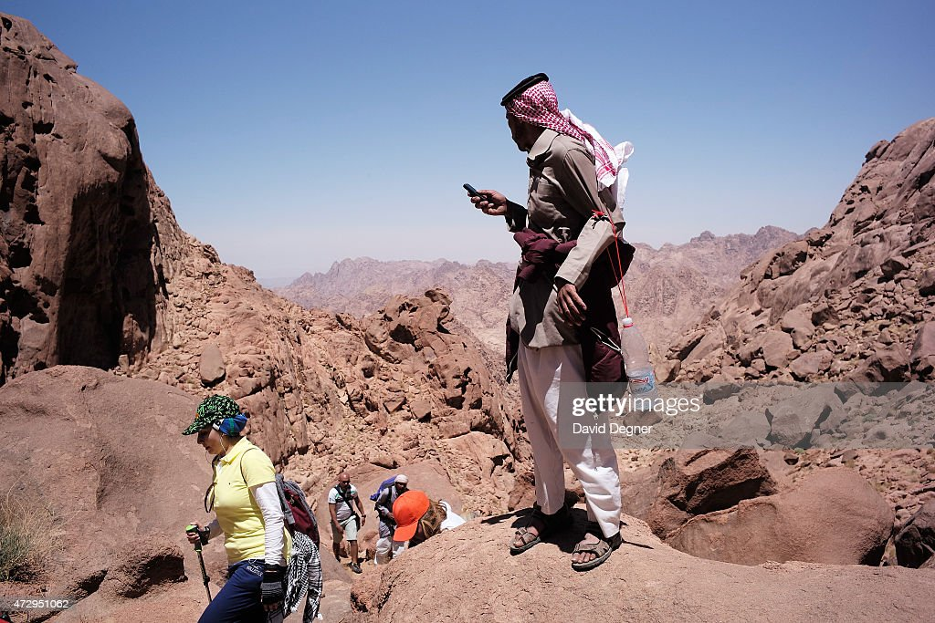 Bedouin guides lead tourists hiking through the mountains of South Sinai on April 17, 2015 near St. Catherine, Egypt. Bedouins guides in the Sinai peninsula face stiff competition and many Sinai Bedouins are unemployed due to the lack of employment opportunities.