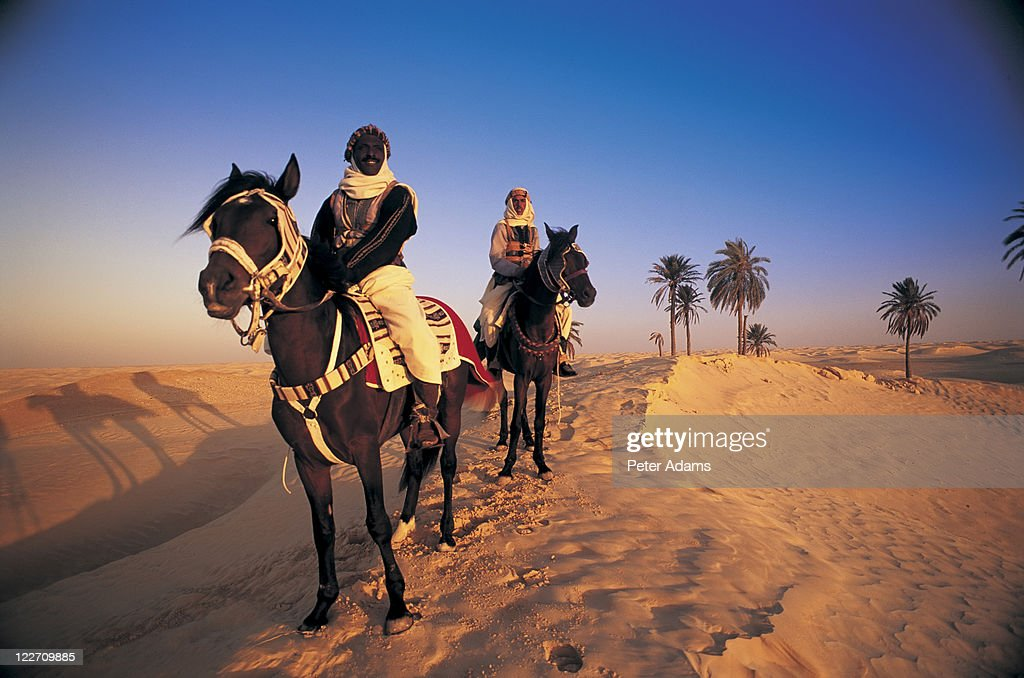Bedouin Horsemen in Desert, Tunisia : Stock Photo