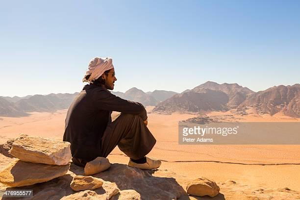 Bedouin man looking over desert, Wadi Rum, Jordan