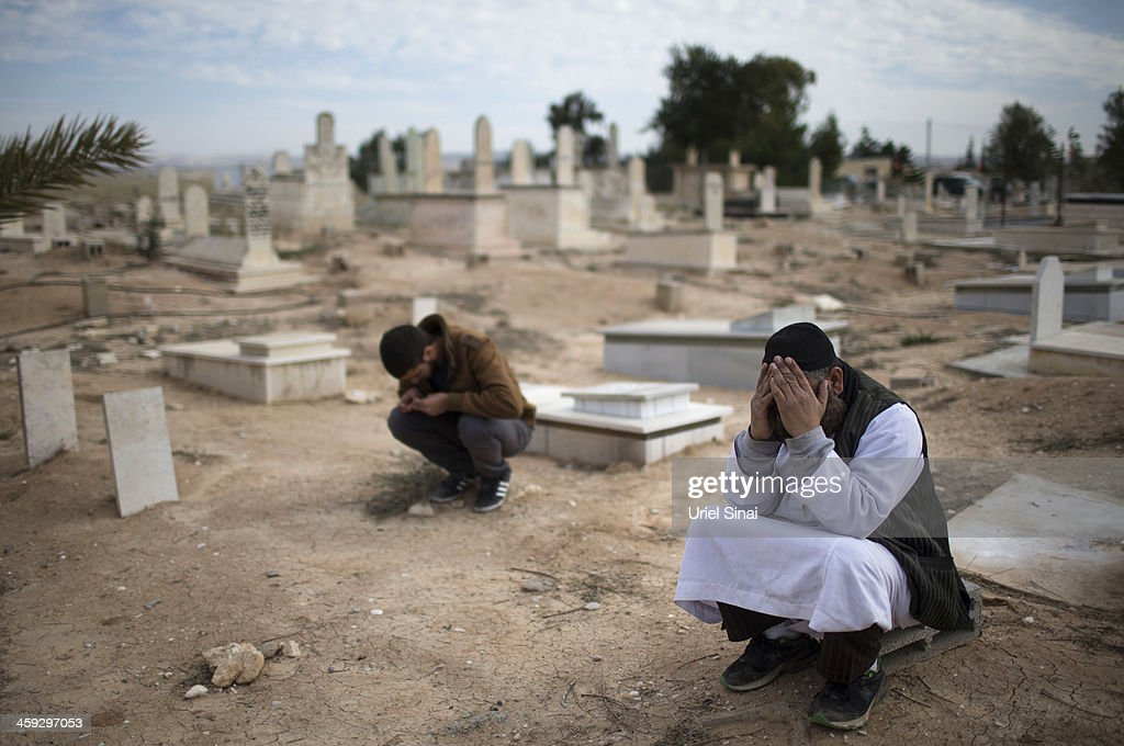 Bedouin mourners take part in a funeral for Saleh Abu Latif, 22, on December 25, 2013 in Rahat, Israel. Abu Latif, An Israeli security fence worker, was killed yesterday from a Palestinian sniper's fire as he was mending the Israel - Gaza border fence.