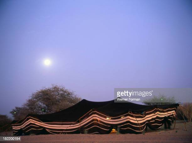 A Bedouin tent at night Formerly a common sight throughout the Arab world they are rarely used in the Emirates today United Arab Emirates Islamic