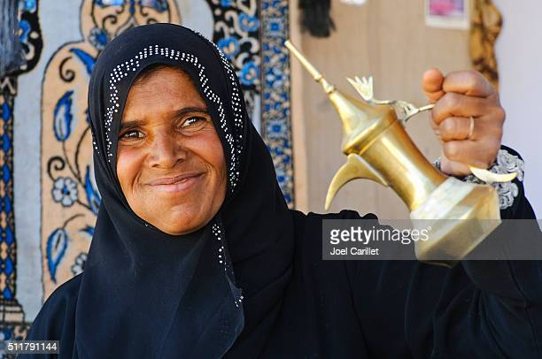 Bedouin woman and coffee pot