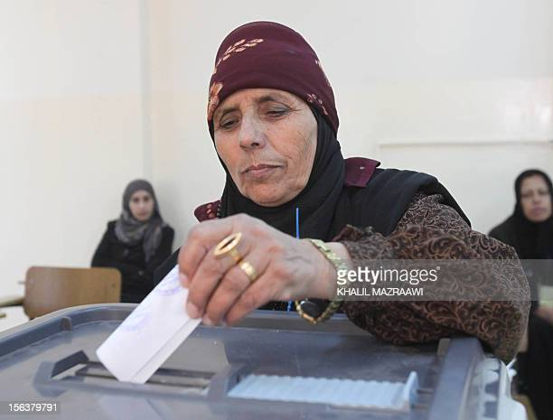 A Bedouin woman casts her ballot at a polling station in Amman on November 9 in an early general election likely to produce MPs with tribal links and...
