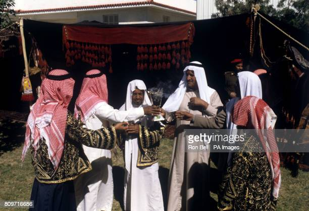 Bedouins burn incense and drink coffee outside a huge tent in Riyadh where Queen Elizabeth II saw some of the local crafts and customs