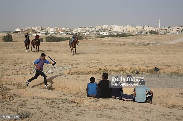 Bedouins ride their horses in the southern Israeli Bedouin town of Ar'arat anNaqab in the Negev desert on May 1 2016 / AFP / MENAHEM KAHANA
