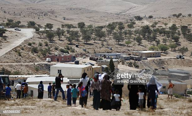 Bedouins take part in a protest against a plan to uproot the Umm AlHiran village which is not recognized by the Israeli government near the southern...