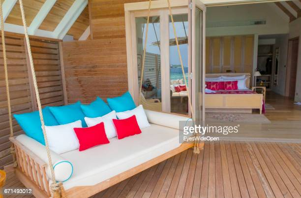 Bedroom and Terrace with a Porch Swing of a Water Villa of the Lifestyle Resort Milaidhoo Island BaaAtoll on February 21 2017 in Male Maldives