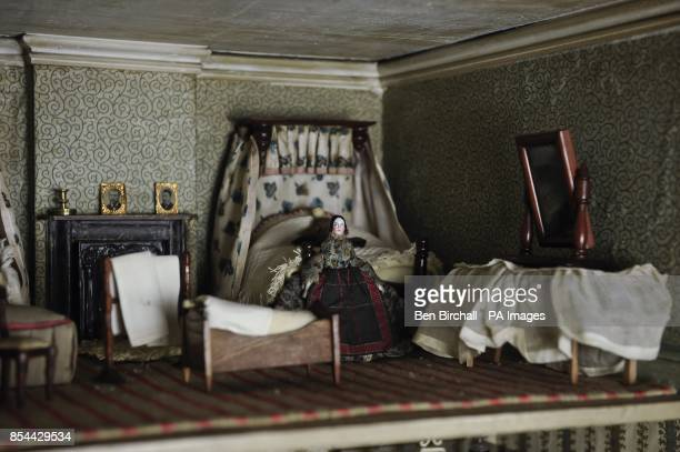 A bedroom in a Victorian doll's house which is to be auctioned at Chorley's in Gloucestershire on 28 November 2013