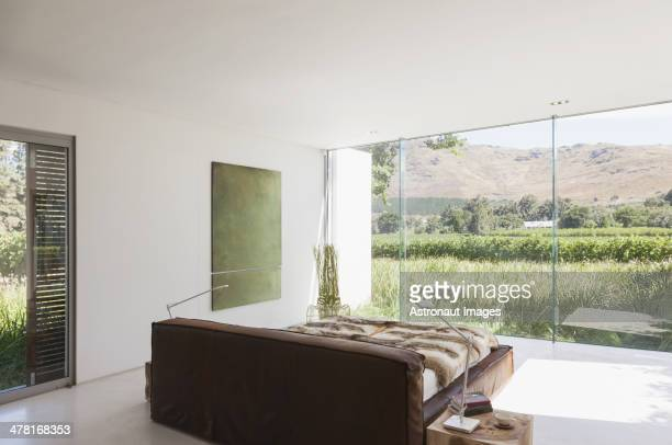 Bedroom in modern house overlooking rural landscape