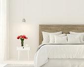 3D illustration. Interior of the bedroom in white color and with tulips on the bedside table