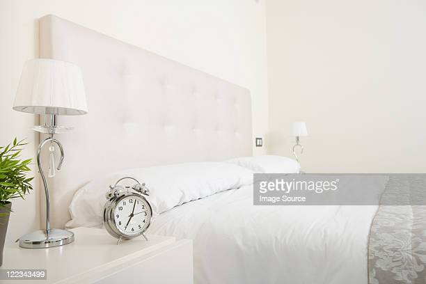 Bedroom in white with double bed