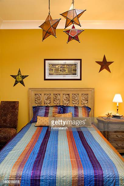 Bedroom Interior With Striped Bedspread and Decorative Stars