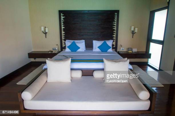 Bedroom of a Water Villa at Coco Bodu Hiti NorthMaleAtoll on February 23 2017 in Male Maldives