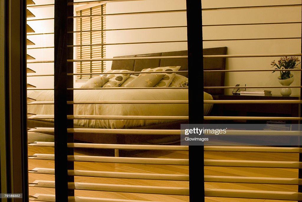 Bedroom viewed through a window : Foto de stock