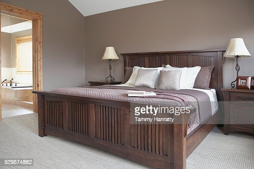 Bedroom with adjoining bathroom : Stock Photo