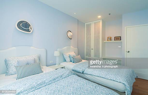 Bedroom with blue painted walls