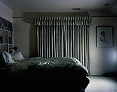 Bedroom with closed curtain