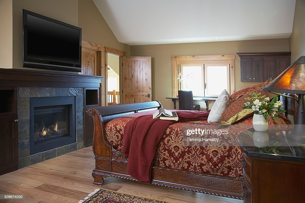 Bedroom with fireplace : Stock Photo