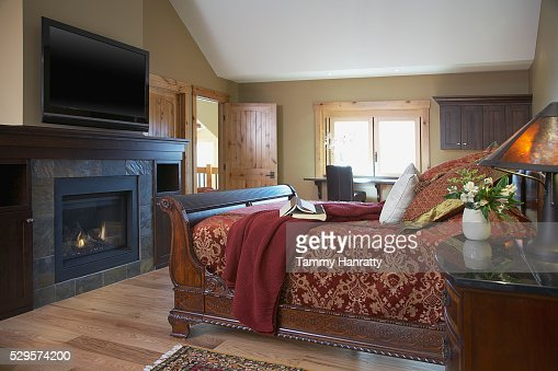 Bedroom with fireplace : Stockfoto