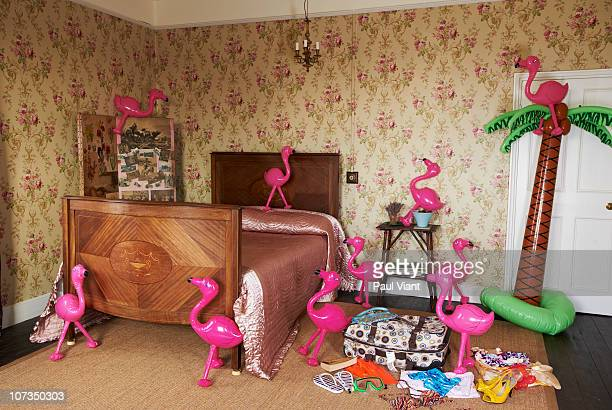 bedroom with inflatable flamingo's