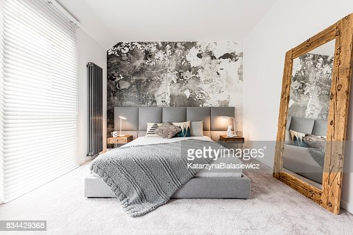 Bedroom with large wooden mirror : Stock Photo
