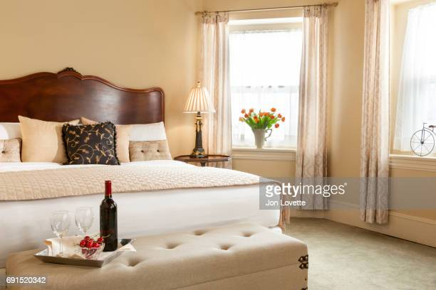 Bedroom with wine, cherries and flowers