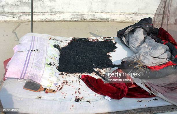 A bedsheet that got burnt in the acid attack on a Russian woman at a house in Nand Nagar locality on November 14 2015 in Varanasi India The 23yearold...