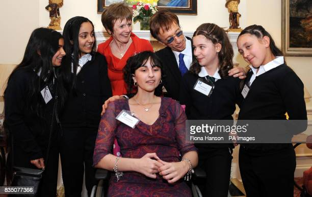 Bee Gee Robin Gibb attending a reception for Diana Award winners at 11 Downing Street with head of the charity Maggie Turner winners Nicole Drysburgh...