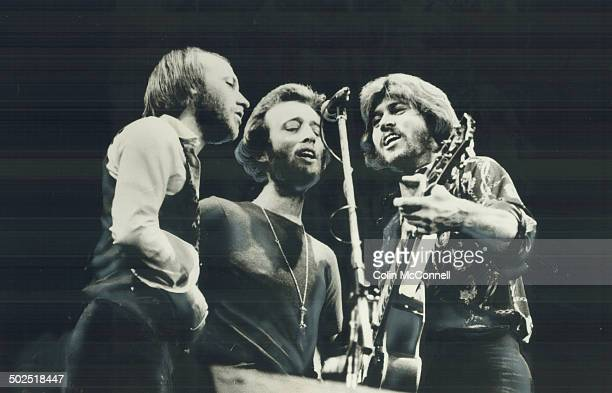 Bee Gees are ready to quit touring Maurice Robin and Barry Gibb are at the top but have decided to take things easier