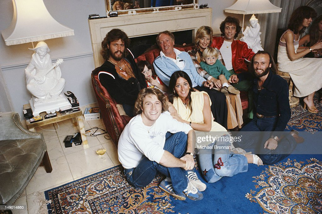Bee Gees Robin, Maurice and Barry Gibb with their brother Andy Gibb (1958 - 1988, front left) and manager Robert Stigwood, in Miami, Florida, March 1978. Barry's wife Linda is at the front.