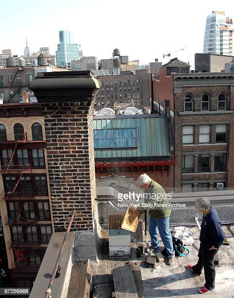 Bee keeper David Graves and restaurant owner Peter Hoffman tend to the roof top bee hives on Hoffman's East Village home