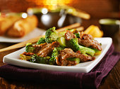 beef and broccoli chinese stirfry on white plate