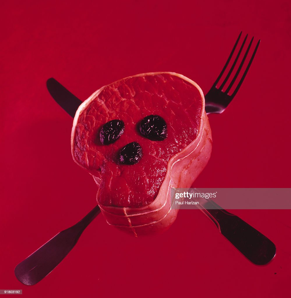 Beef and silverware as skull and crossbones : Stock Photo