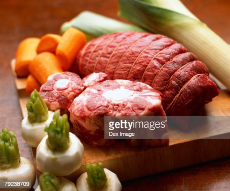 Beef and vegetables on chopping board : Stock Photo