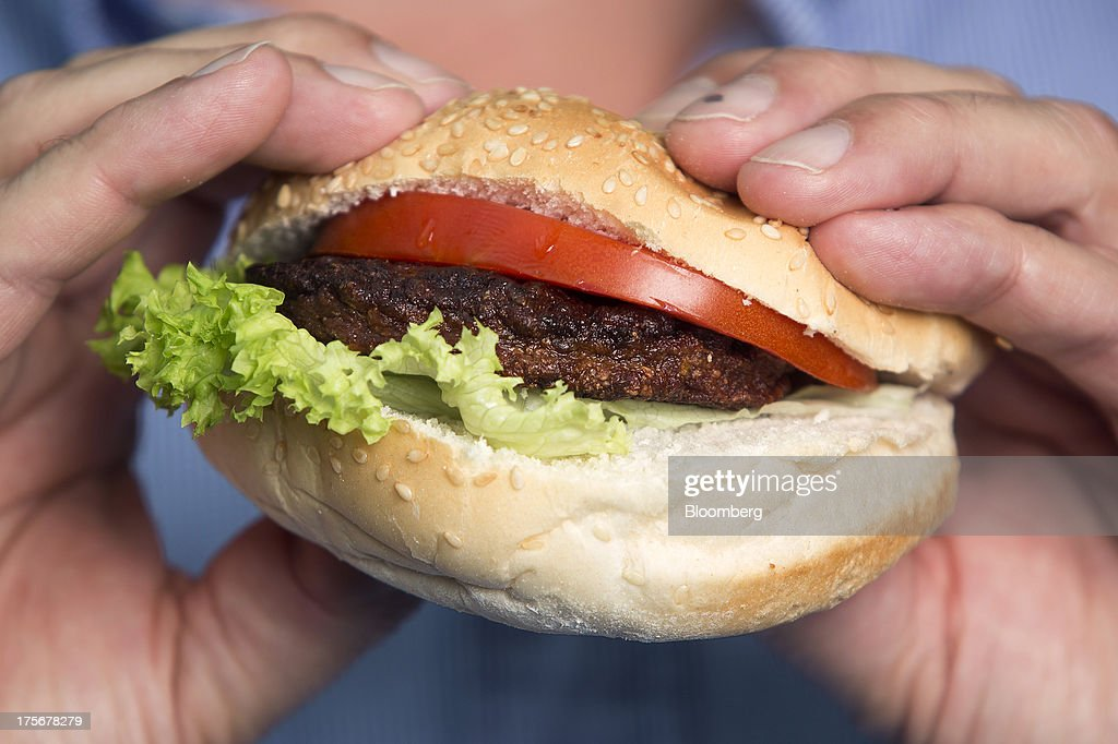 A beef burger created by stem cells harvested from a living cow is held for a photograph by Mark Post, a Dutch scientist, following a Bloomberg Television interview in London, U.K., on Tuesday, Aug. 6, 2013. The 5-ounce burger, which cost more than 250,000 euros ($332,000) to produce, was developed by Post of Maastricht University with funding from Google co-founder Sergey Brin. Photographer: Simon Dawson/Bloomberg via Getty Images